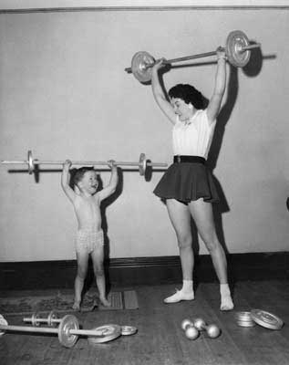 woman and child in gym