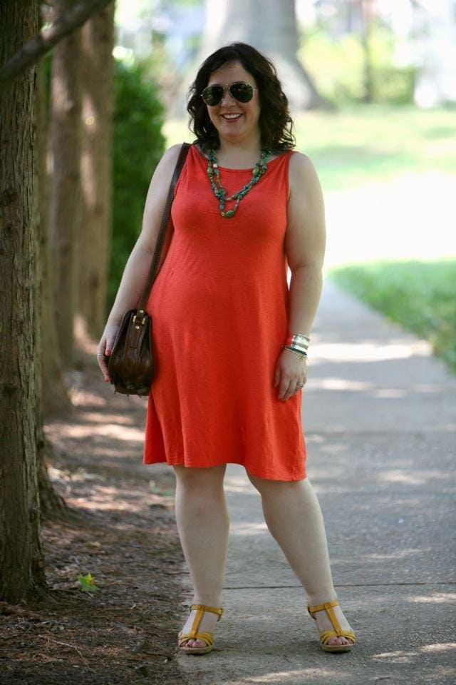 Eileen Fisher orange dress with turquoise bead necklace on Alison Gary of Wardrobe Oxygen