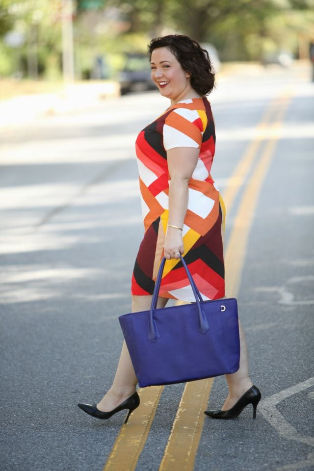 Wardrobe Oxygen wearing a Vince Camuto shift dress and Dagne Dover tote