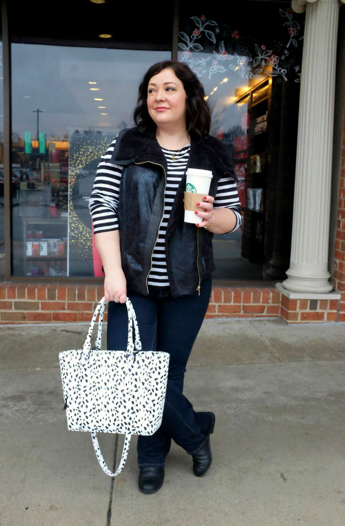 Wardrobe Oxygen wearing a Modamix vest from Gwynnie Bee, JAG Jeans Foster Bootcut, and Dagne Dover limited edition Mini Tote in leather