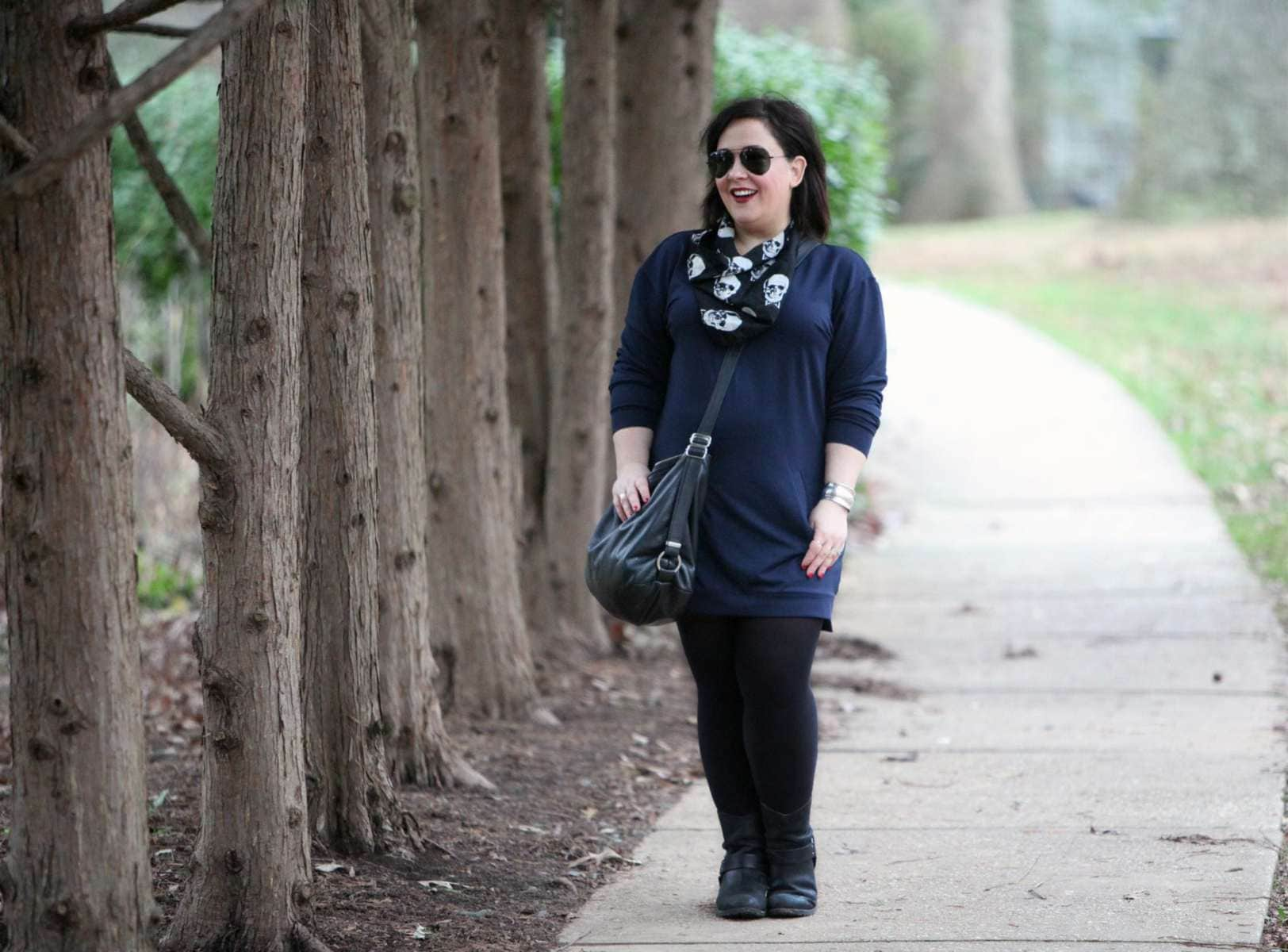 Wardrobe Oxygen, an over 40 fashion and personal style blog, featuring a navy sweatshirt dress and black harness boots
