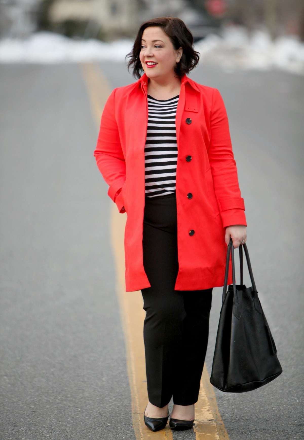 Wardrobe Oxygen wearing an orange Ann Taylor trench with black and white stripes
