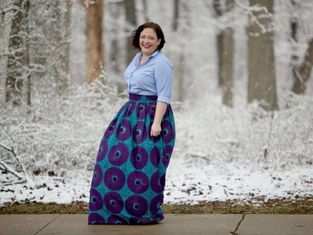 Wardrobe Oxygen wearing a Lands' End striped button front shirt with blue ankara maxi skirt