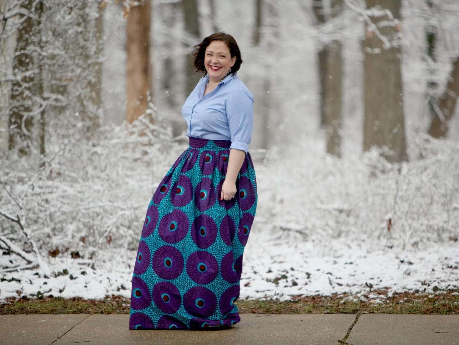 Wardrobe Oxygen wearing a Lands' End striped button front shirt with blue ankara maxi skirt