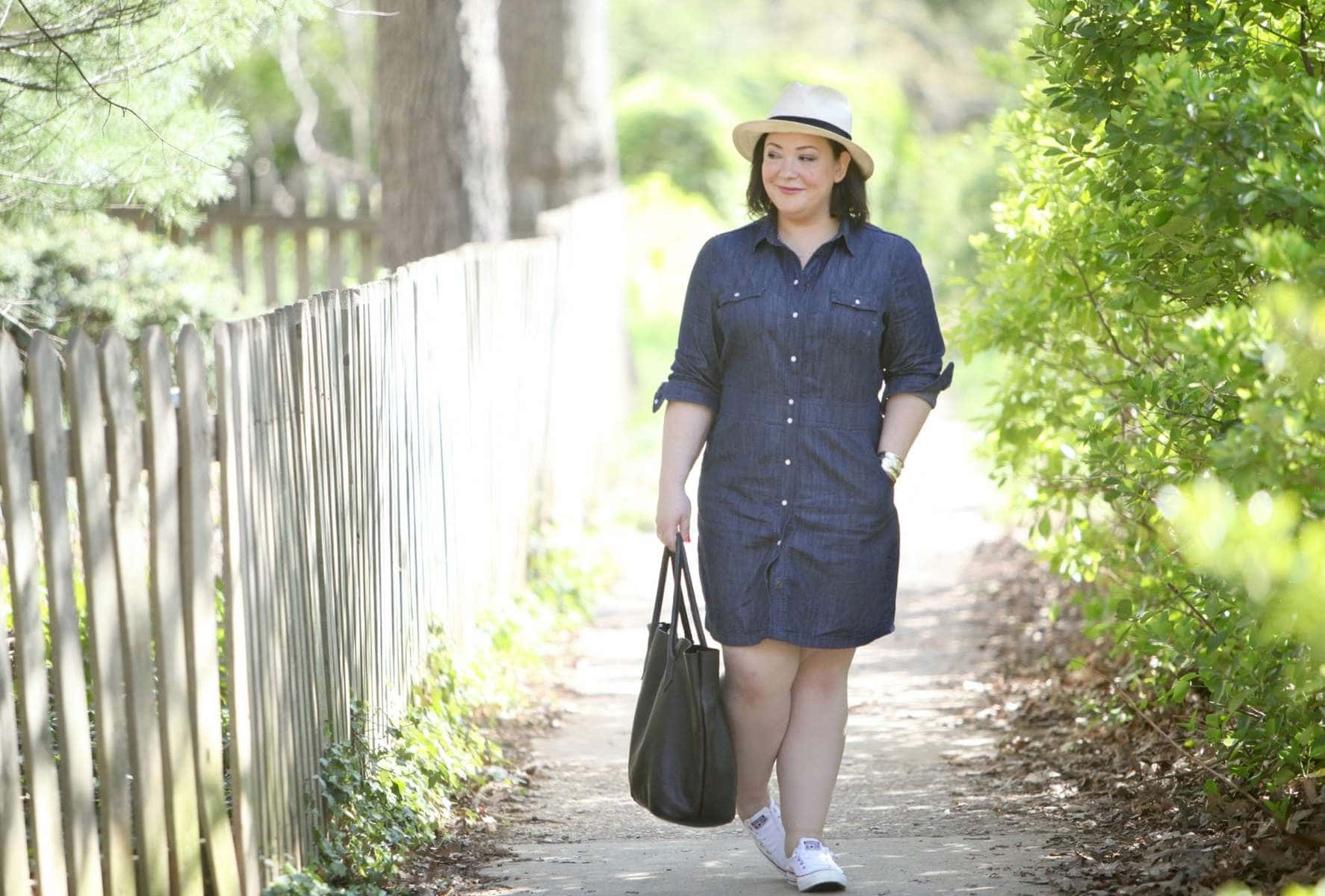 Over 40 fashion blog Wardrobe Oxygen in a Boden dress, Converse sneakers, and carrying an Adora Bags tote