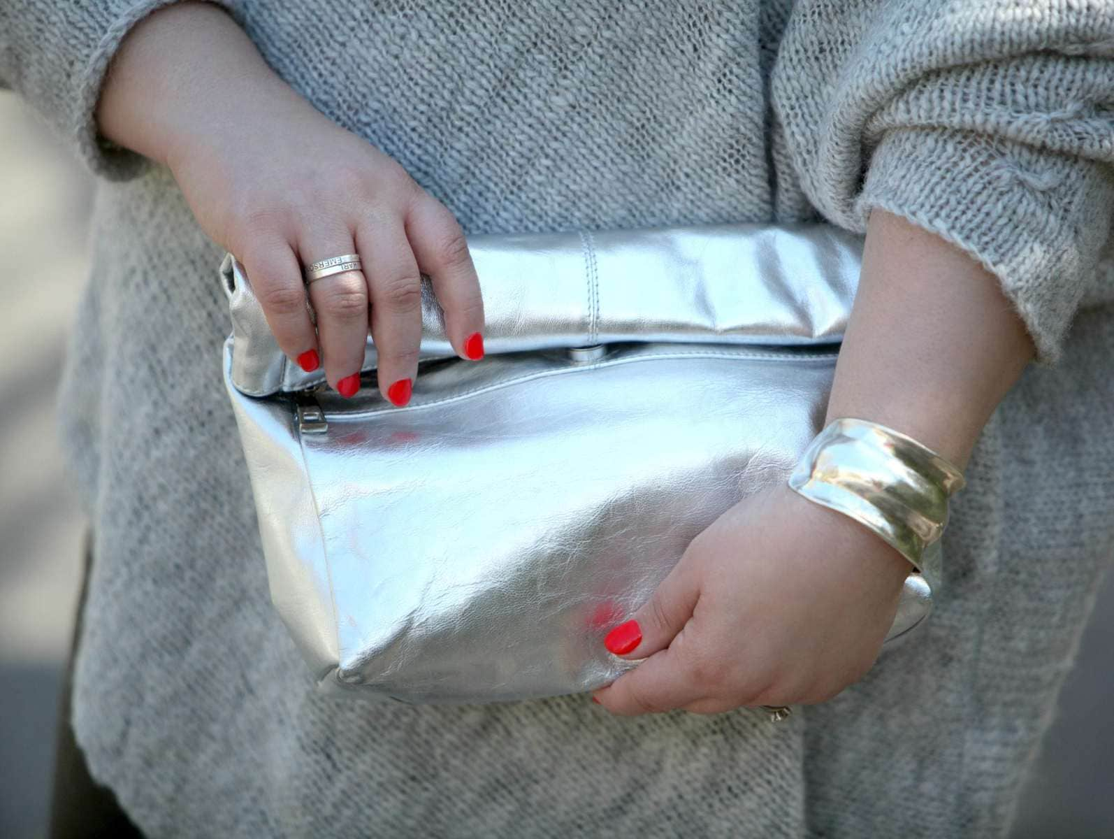 Wardrobe Oxygen, an over 40 fashion blogger wearing a Stella Carakasi alpaca sweater, faux leather leggings, and a Topshop silver leather clutch