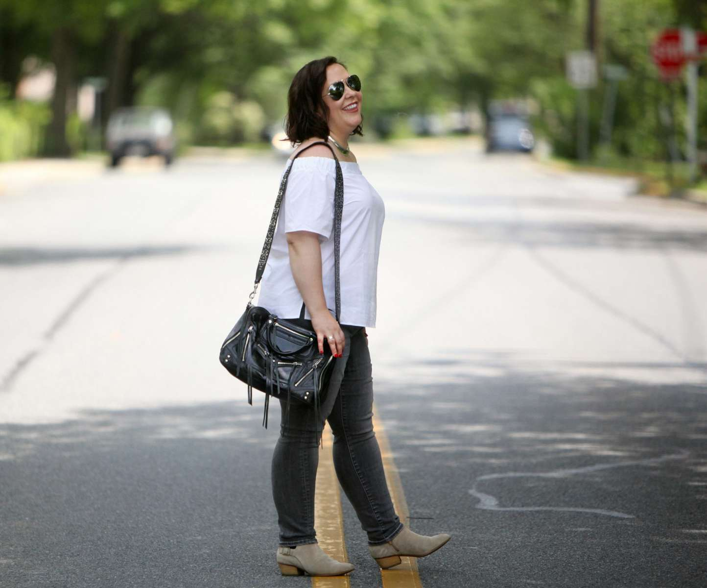 wardrobe oxygen wearing an asos off the shoulder top and rebecca minkoff bag