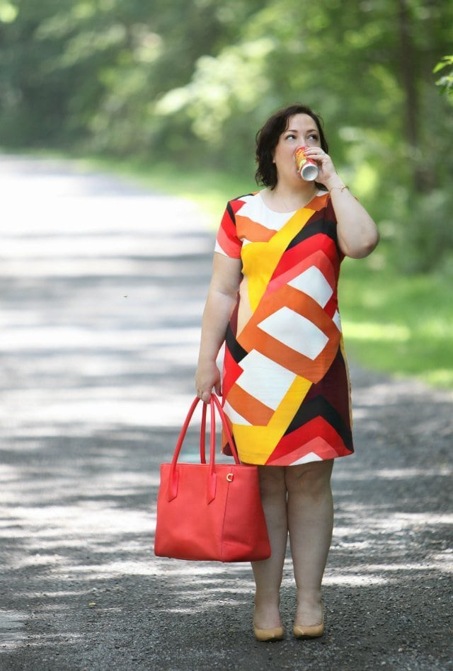 Wardrobe Oxygen in a Vince Camuto Dress and carrying a Dagfne Dover 15 inch tote