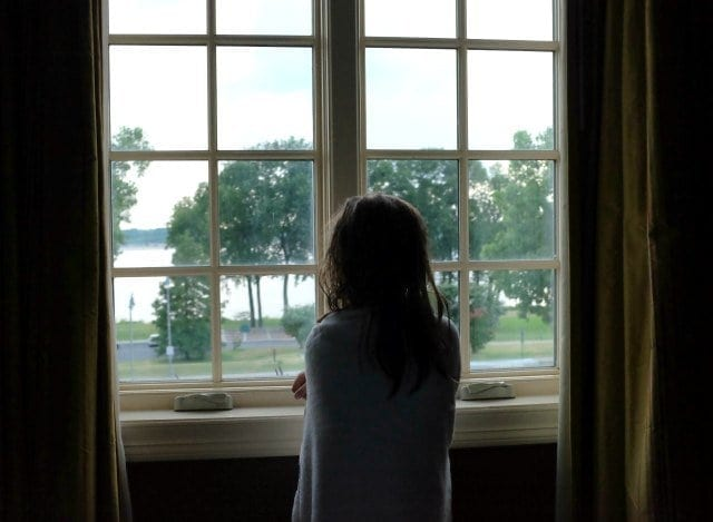 Emerson at the window of Little River Inn Memphis