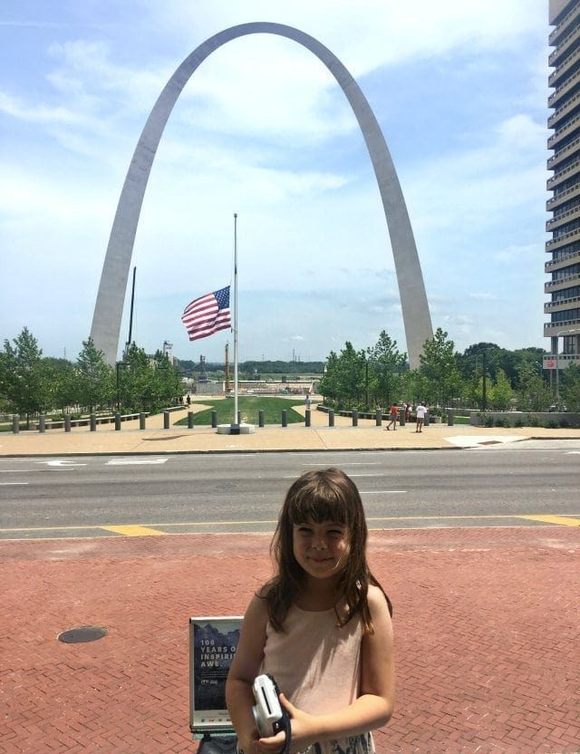 Emerson on the Courthouse stairs with the Gateway Arch in the Background