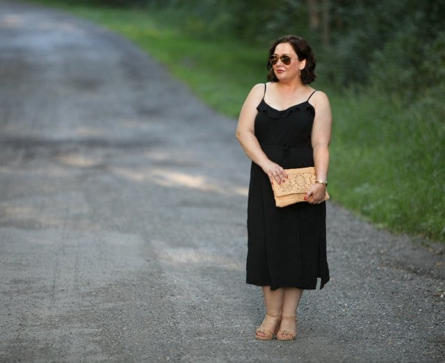 Wardrobe Oxygen Over 40 blogger in black sundress from ASOS with straw clutch