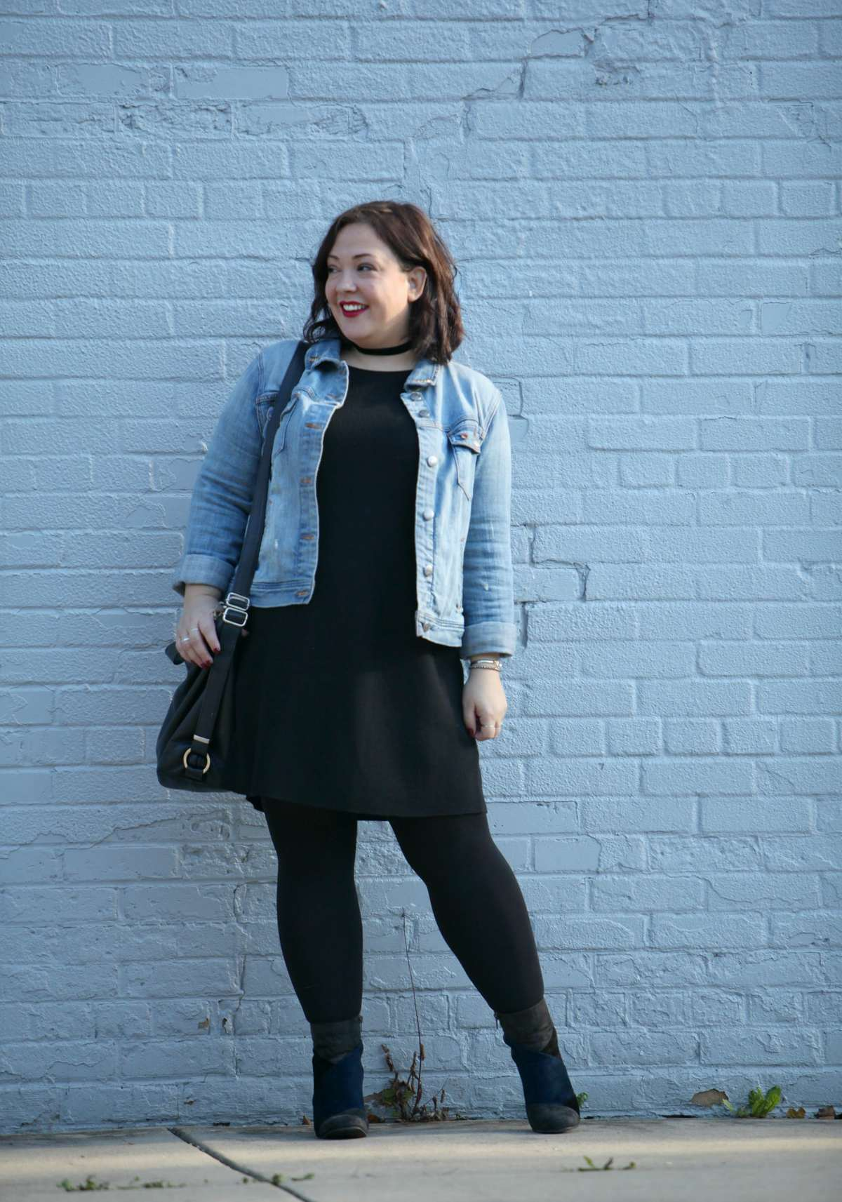 Alison Gary of Wardrobe Oxygen in an Eileen Fisher dress, J. Crew denim jacket, and 7 Dial Shoes patchwork ankle boots