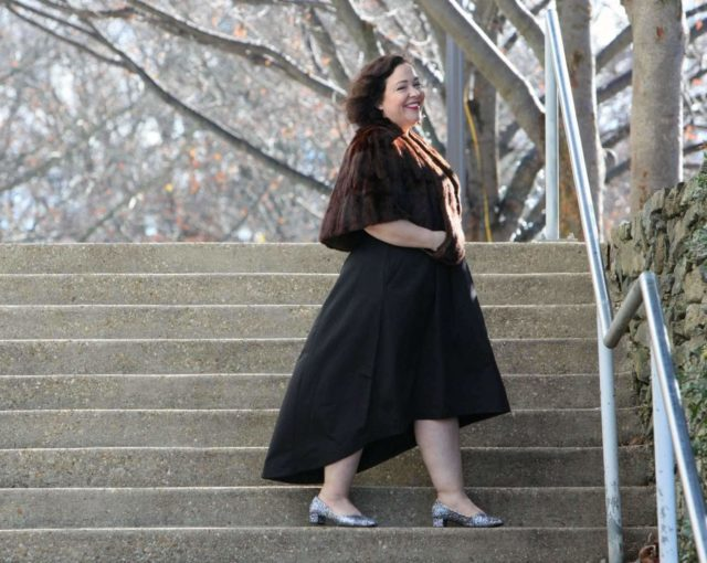 Wardrobe Oxygen in a vintage fur capelet, CityChic high-low evening dress and glitter pumps from J. Renee