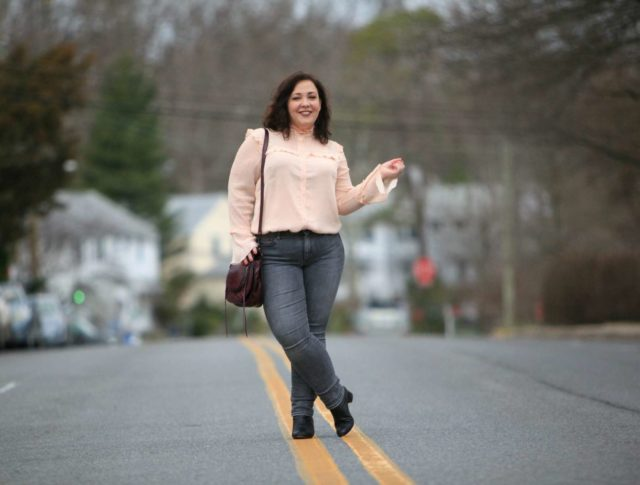 Wardrobe Oxygen in a peach ELOQUII blouse with grey Gap jeans