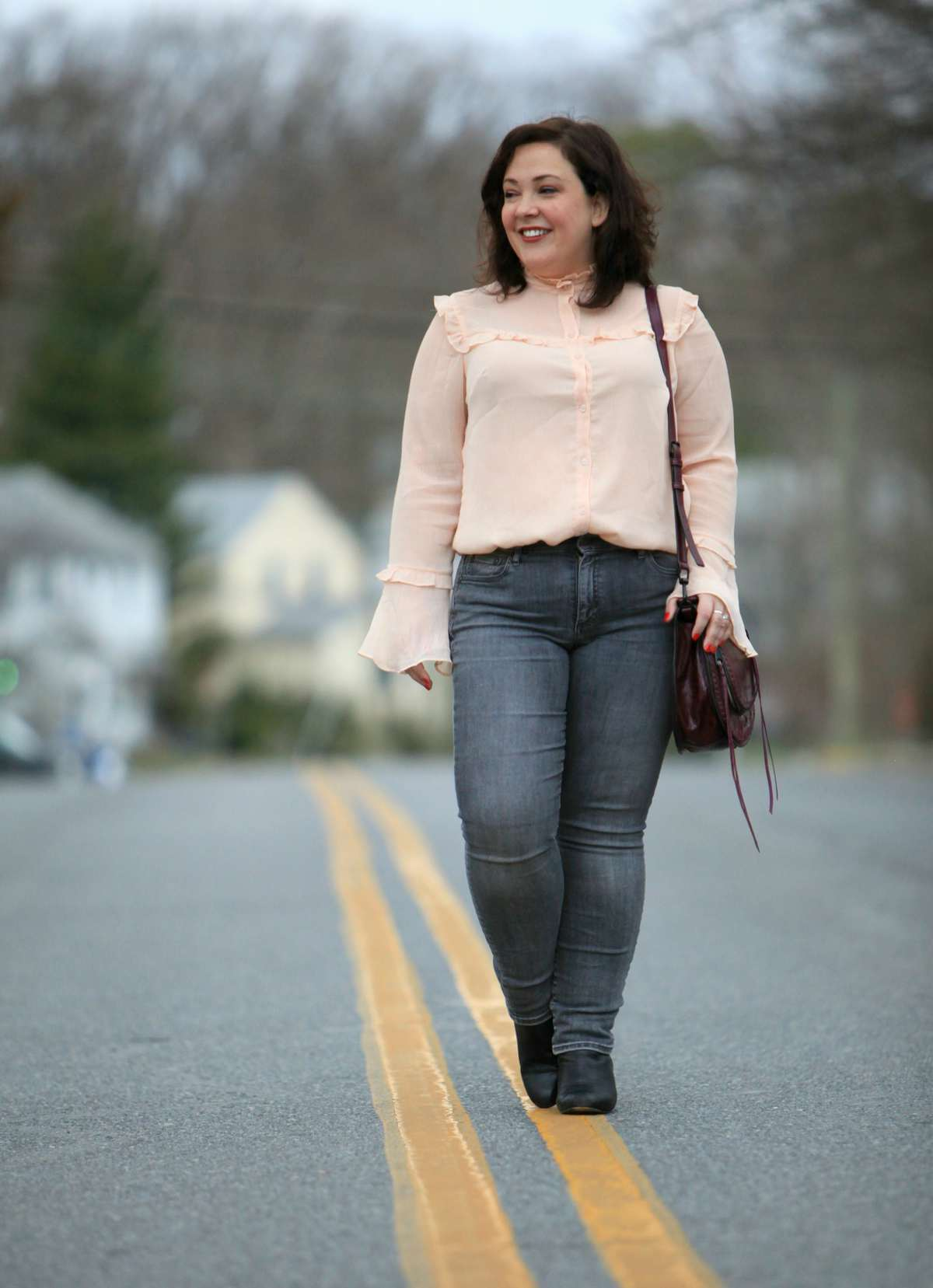 Wardrobe Oxygen over 40 fashion blogger in ELOQUII blouse and Gap Real Straight jeans