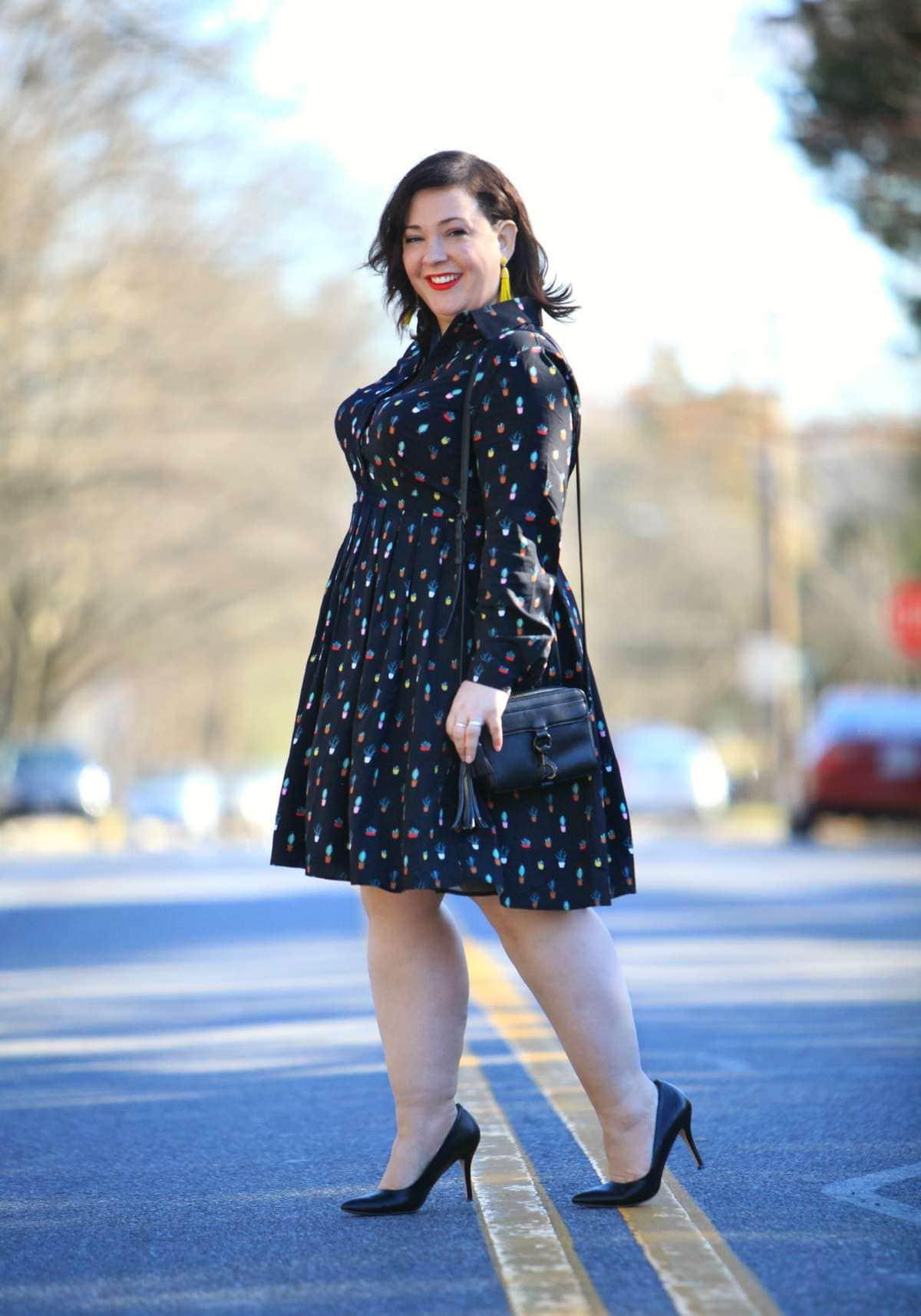 Wardrobe Oxygen in an Eloquii Conversational Dress, Rebecca Minkoff bag, and Baublebar tassel earrings