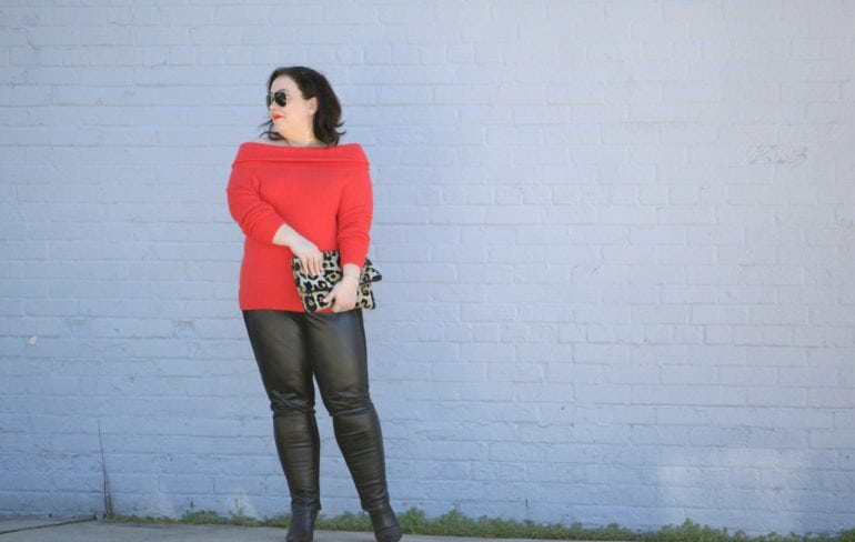 Wardrobe Oxygen, over 40 size 14 fashion blogger in a Vince Camuto sweater from Gwynnie Bee styled with Stella Carakasi faux leather front ponte pants and a leopard clutch from Love,Cortnie wear red