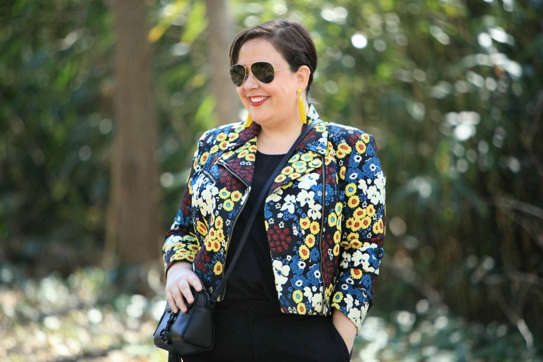 Wardrobe Oxygen wearing a Rachel Roy Curve floral moto jacket with Ray-Ban 62mm aviators and a Rebecca Minkoff bag