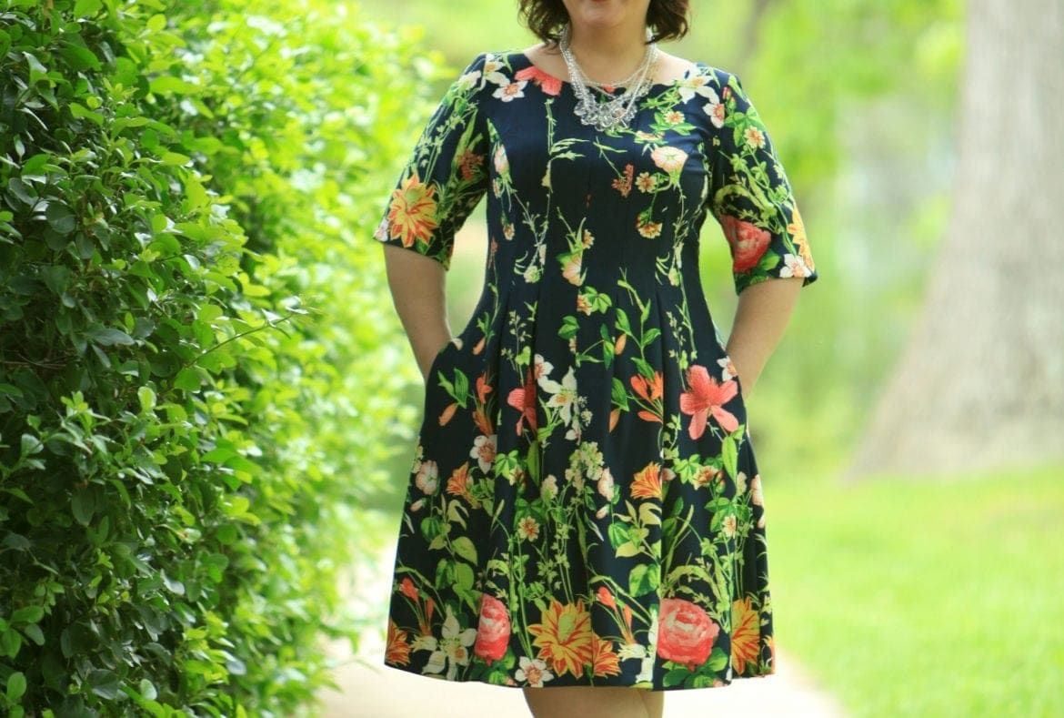 Wardrobe Oxygen in a Gabby Skye floral fit and flare dress via Gwynnie Bee with a Baublebar necklace and Nine West pumps fit and flare dress with sleeves