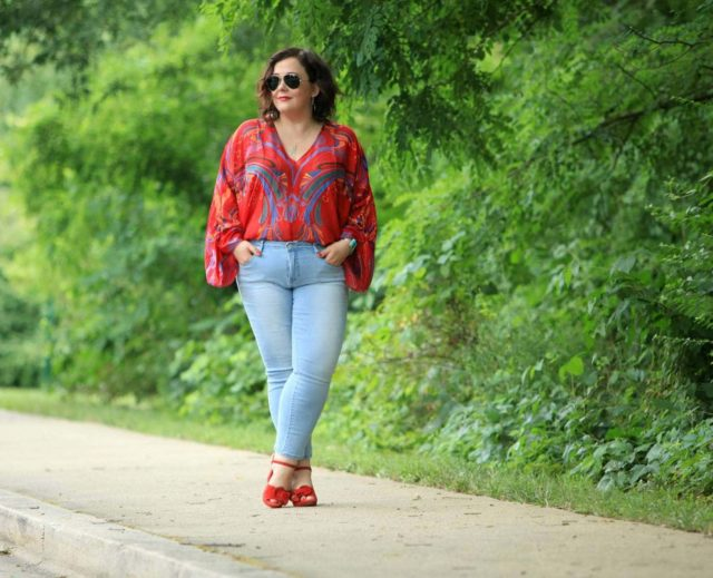 0209a7aee Alison Gary of Wardrobe Oxygen wearing a red printed chiffon blouse from  Free People with light