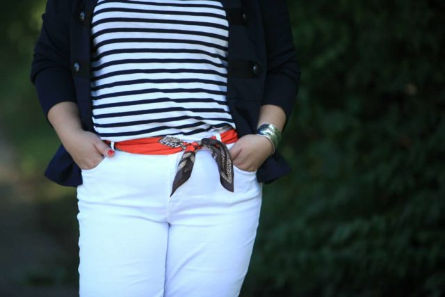 Wardrobe Oxygen wearing the cabi Deidre Scarf as a belt with white jeans, a Breton top, and the cabi In The Band jacket