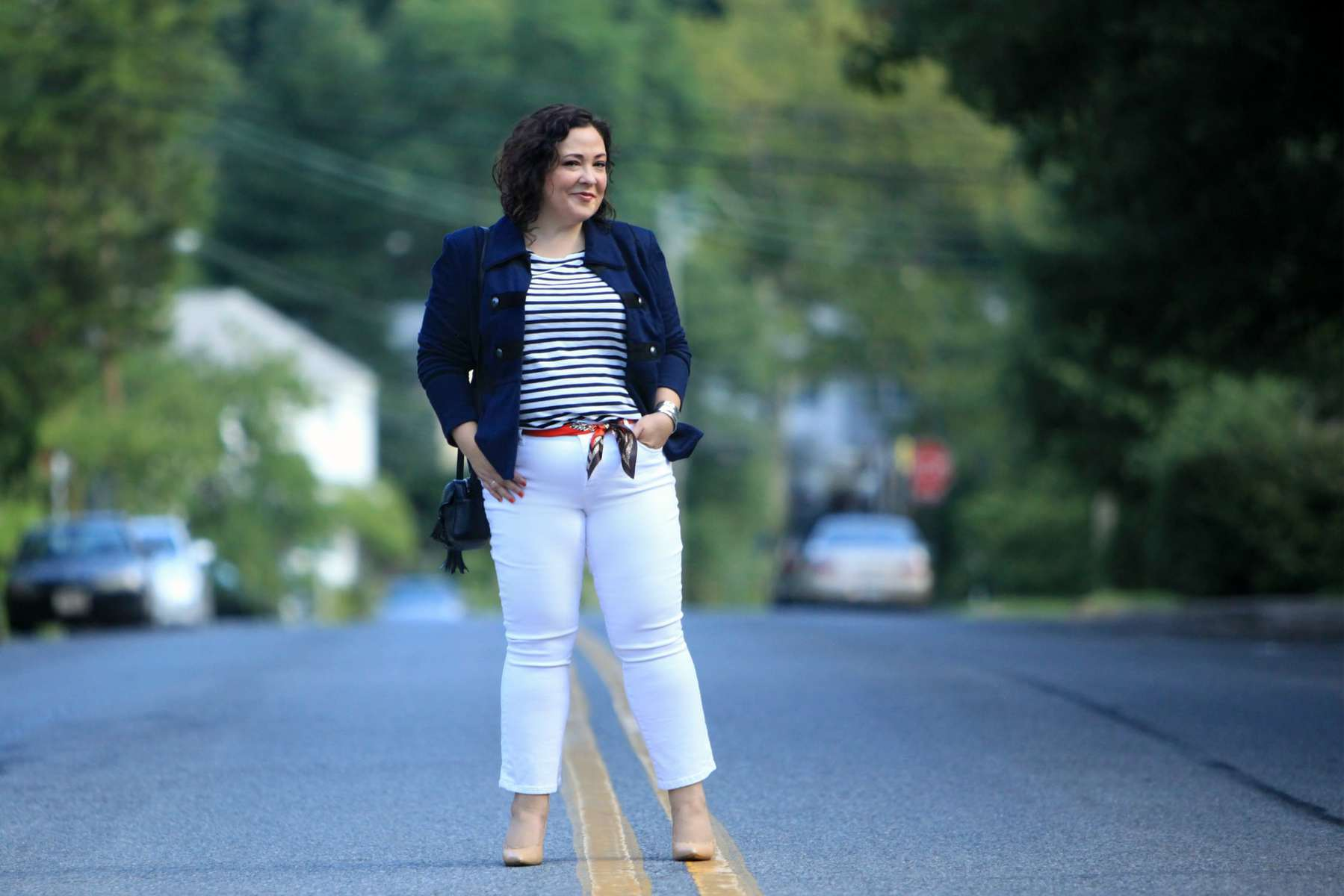 Wardrobe Oxygen wearing the cabi In The Band Jacket with a Breton tee, white cropped jeans, nude pumps, and the cabi Deidre Scarf worn as a belt