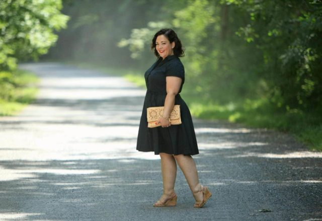 Wardrobe Oxygen in a black cotton shirt dress from ellos with Aerosoles wedge sandals and a raffia clutch bag