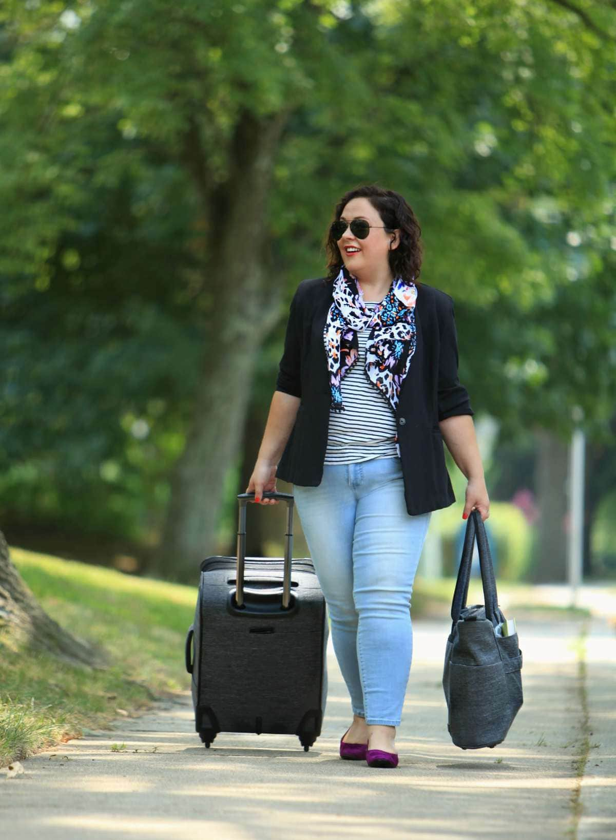 Wardrobe Oxygen dressed for travel in a cabi scarf, JAG Jeans and Ricardo Beverly Hills luggage