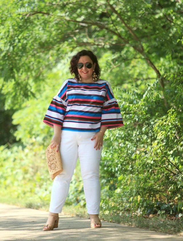 Wardrobe Oxygen in a candy striped cotton bell sleeve blouse from Vince Camuto with white Talbots ankle jeans, Aerosoles sandals, and a raffia clutch