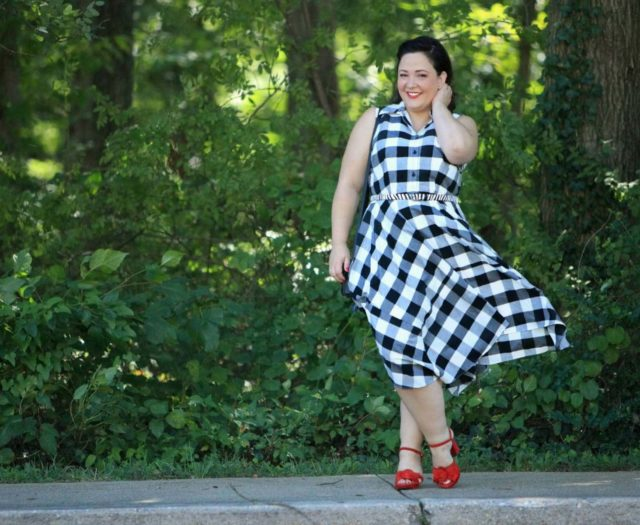 Wardrobe Oxygen in a black and white gingham dress from Gwynnie Bee with a cabi zebra calfhair belt and Naturalizer Adelle red suede platform sandals