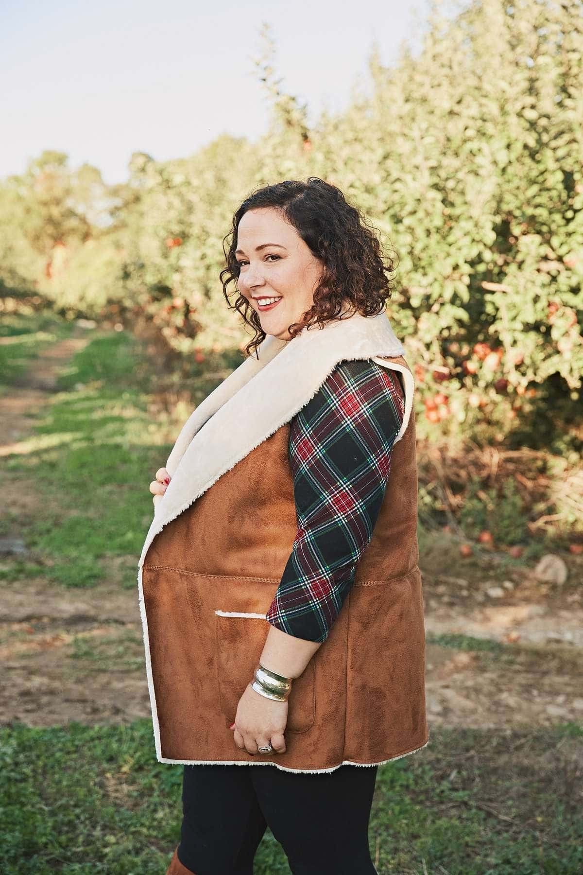 Wardrobe Oxygen in a Jessica London faux shearling vest and plaid tunic