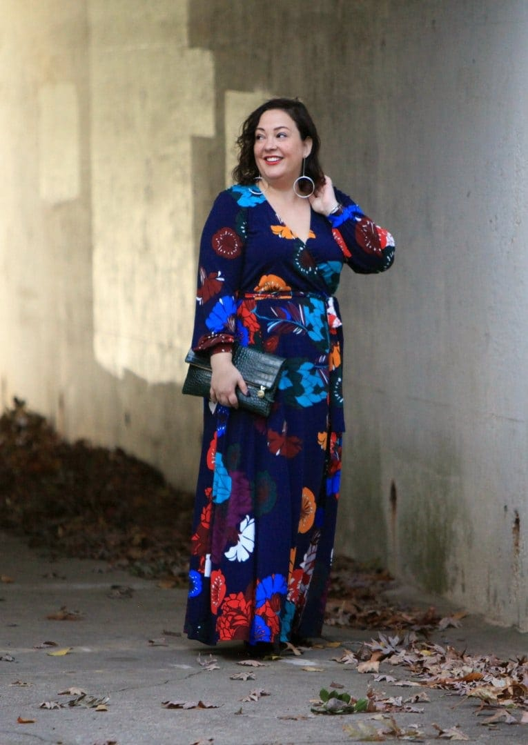 Wardrobe Oxygen in an ELOQUII dark floral maxi dress with an Ellos black faux fur coat and Clare V green crocs clutch