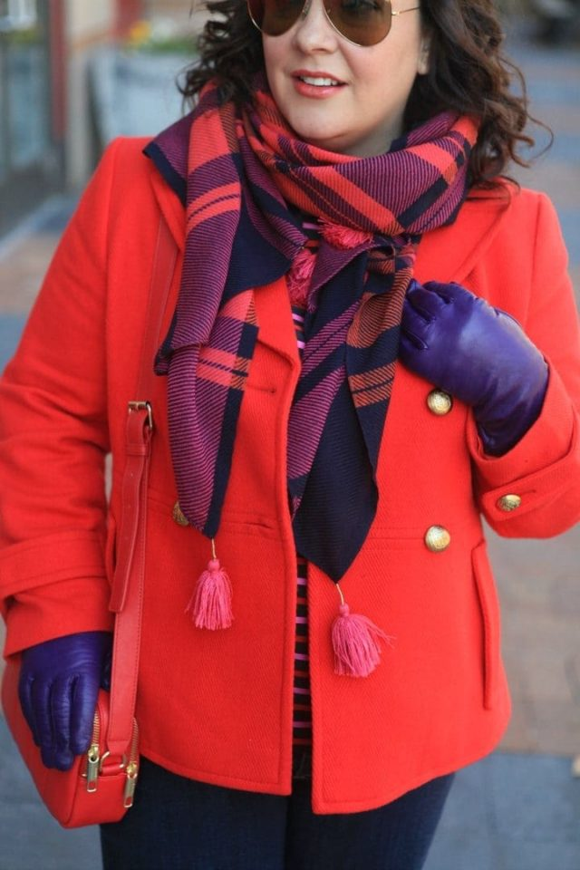 Wardrobe Oxygen in a red Talbots peacoat, plaid scarf, and purple leather gloves