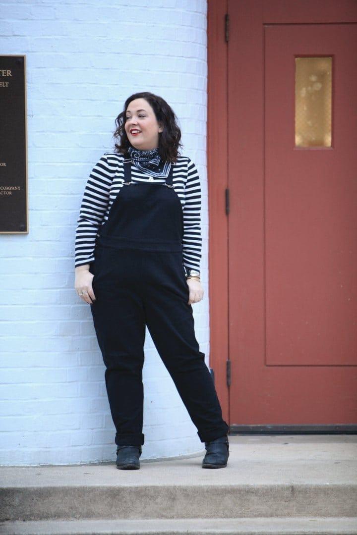 universal standard overalls in black on wardrobe