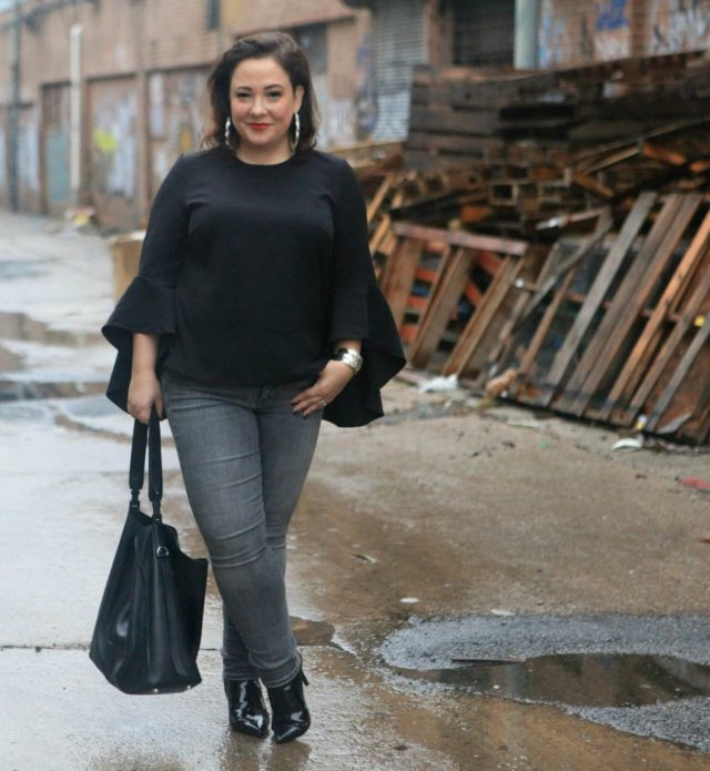 wardrobe oxygen in an eloquii blouse with the allsaints paradise tote