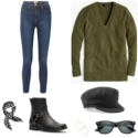 A pair of stretch skinny jeans with a green v-neck tunic sweater, black baker boy cap, black Ray-Ban Wayfarer sunglasses, gold Argento Vivo earrings, black harness boots, and a black and white scarf.