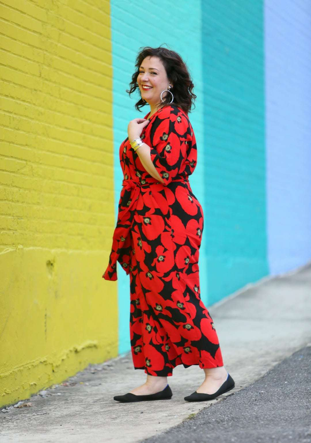 Wardrobe Oxygen in a red floral jumpsuit from ELOQUII with Rothy's flats