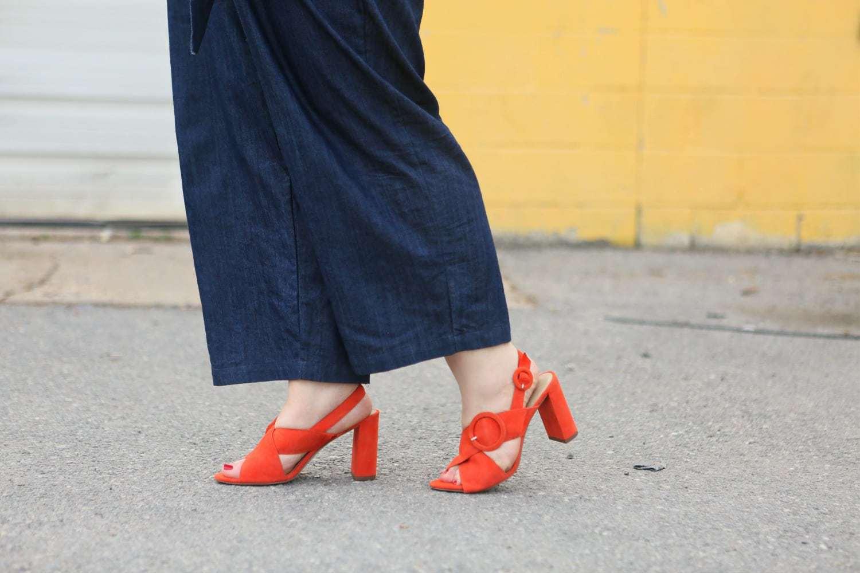 Ann Taylor Magda Suede Buckle Block Heel Sandals in Orange on Wardrobe Oxygen #anntaylor #blockheel - ELOQUII Denim Jumpsuit styled by popular Washington DC petite fashion blogger, Wardrobe Oxygen