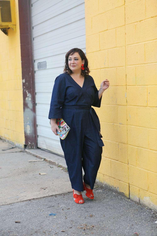 Wardrobe Oxygen in an ELOQUII denim jumpsuit with orange suede Ann Taylor sandals - ELOQUII Denim Jumpsuit styled by popular Washington DC petite fashion blogger, Wardrobe Oxygen
