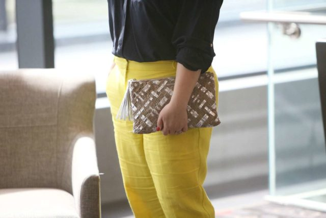 Wardrobe Oxygen in yellow linen pants from Talbots with a navy silk blouse and silver Monserat De Lucca woven clutch