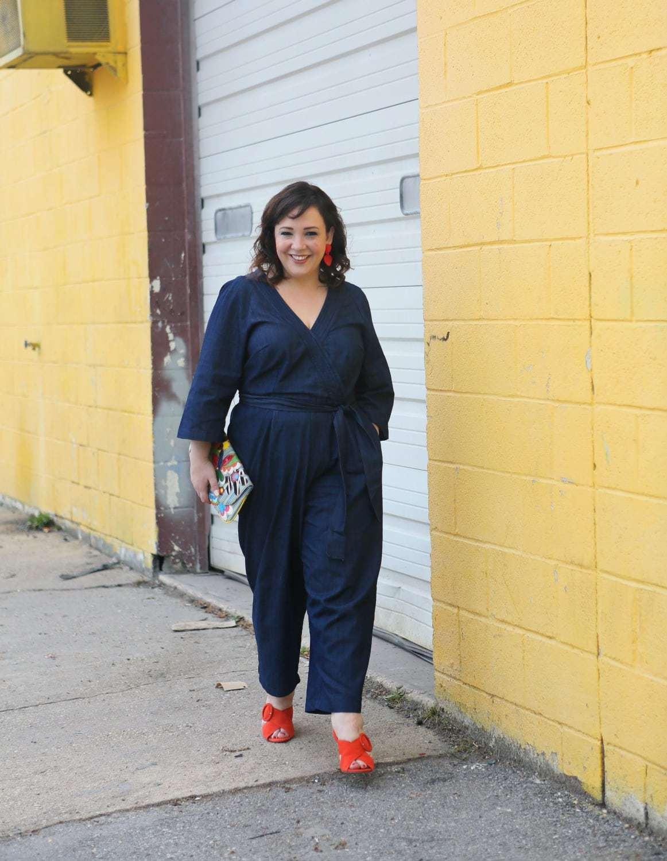 Wardrobe Oxygen in an ELOQUII faux wrap denim jumpsuit with orange suede block heel sandals from Ann Taylor - ELOQUII Denim Jumpsuit styled by popular Washington DC petite fashion blogger, Wardrobe Oxygen