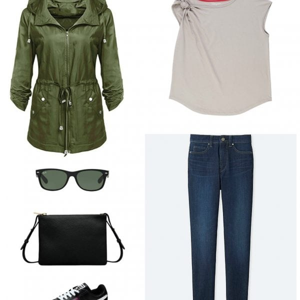 Tan asymmetrical t-shirt with ankle jeans, Puma sneakers, a slim black crossbody bag, sunglasses, and an olive green hooded anorak.