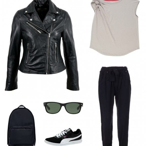 Travel capsule wardrobe look - black joggers, Universal Standard knot shoulder top, black leather Moto jacket, black Wayfarer sunglasses, black Puma sneakers, black backpack.