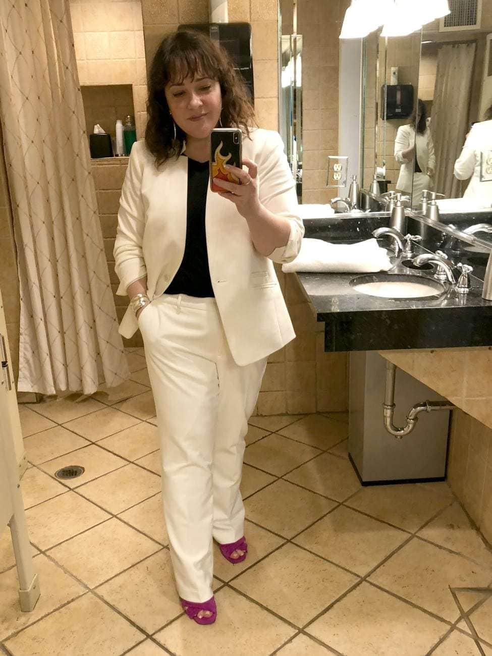ivory pantsuit on wardrobe