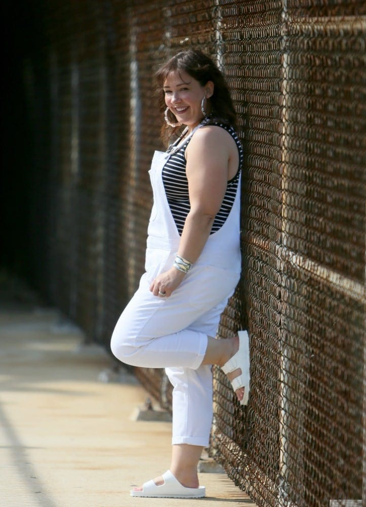 gap white overalls with white birkenstocks and a black and white striped tank top