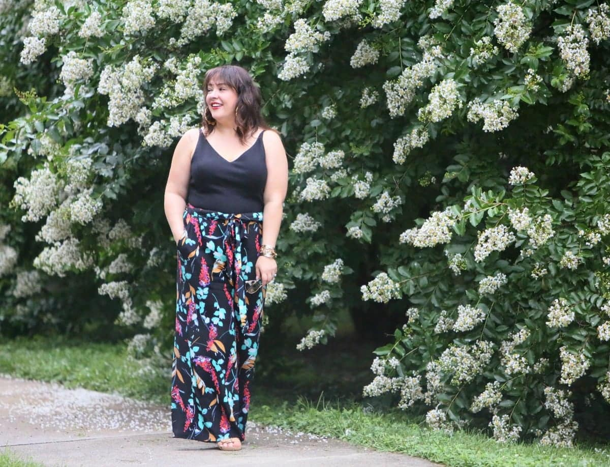 Over 40 fashion blogger Wardrobe Oxygen in a cabi ponte bralette, BP floral paperbag waist wide leg pants, and Aerosoles wedge sandals