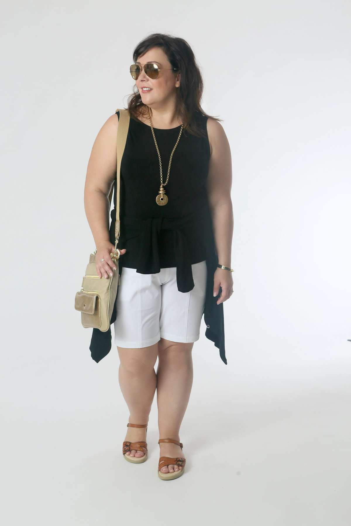 Sightseeing in the tank and shorts with the cardigan around the waist. Great if you visit places that may be chilly or houses of worship that require you to cover your shoulders. Comfy sandals, a crossbody to hold everything, and a necklace for interest.