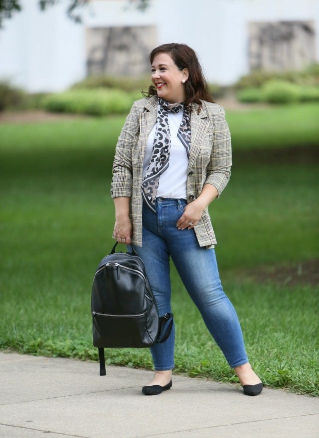 Wardrobe Oxygen in the cabi Pastime jacket and leopard scarf styled with a Universal Standard t-shirt, Banana Republic jeans, Rothy's flats, and the ECCO SP3 backpack for fall