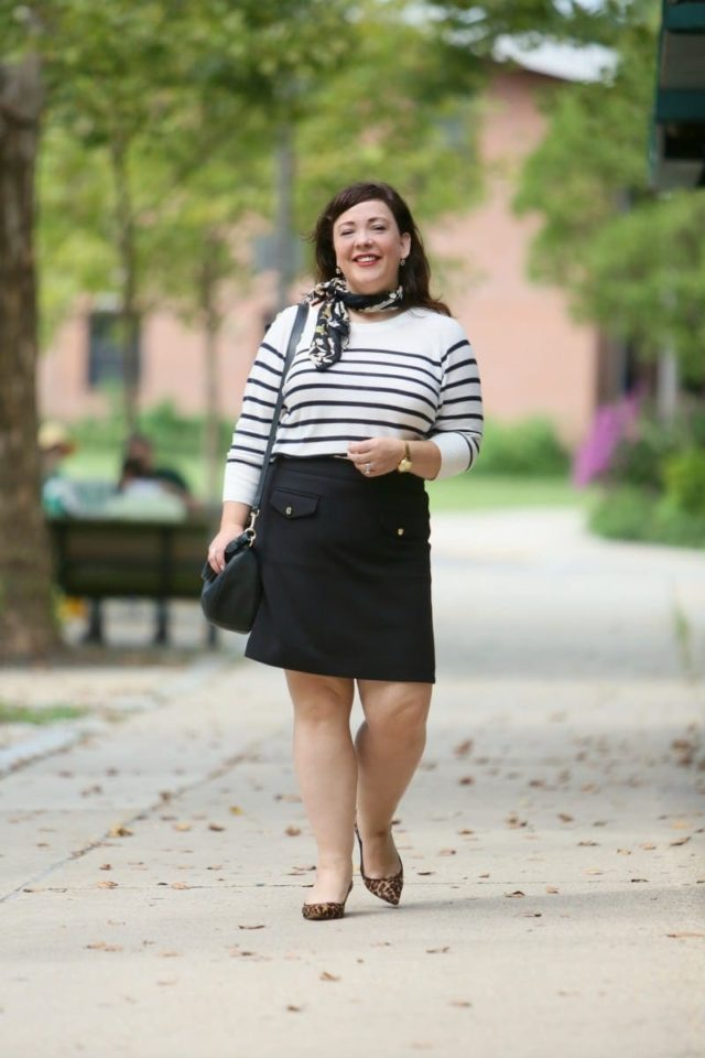 Wardrobe Oxygen in a Breton stripe top and black ponte knit skirt from LOFT styled with a floral scarf and leopard kitten heel pumps