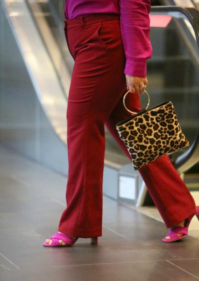 wearing the pink and red trend for fall with a silk blouse and double cloth pants from Talbots